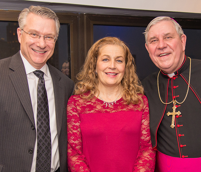 Dr. Dan Scholz and his wife, Bonnie, with Most Reverend Jerome E. Listecki, Archbishop of Milwaukee