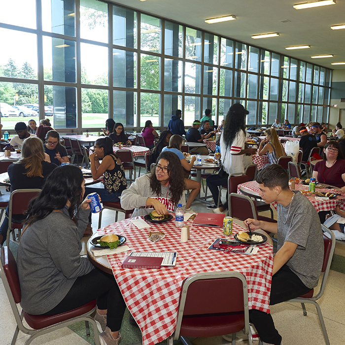 students in cafeteria eating lunch
