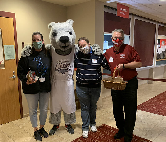 <p>Interim President Dr. Dan Scholz and Wolfy visited with Stritch faculty and staff on National Employee Appreciation Day on March 5, 2021.</p>